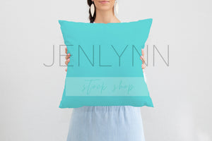 Woman Holding Square Pillow Mockup #10 PSD