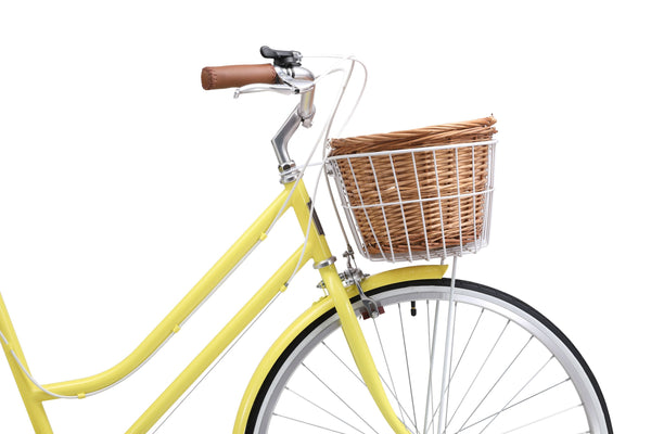 Ladies Classic Plus Vintage Bike in Lemon on front angle featuring front wicker basket from Reid Cycles Australia