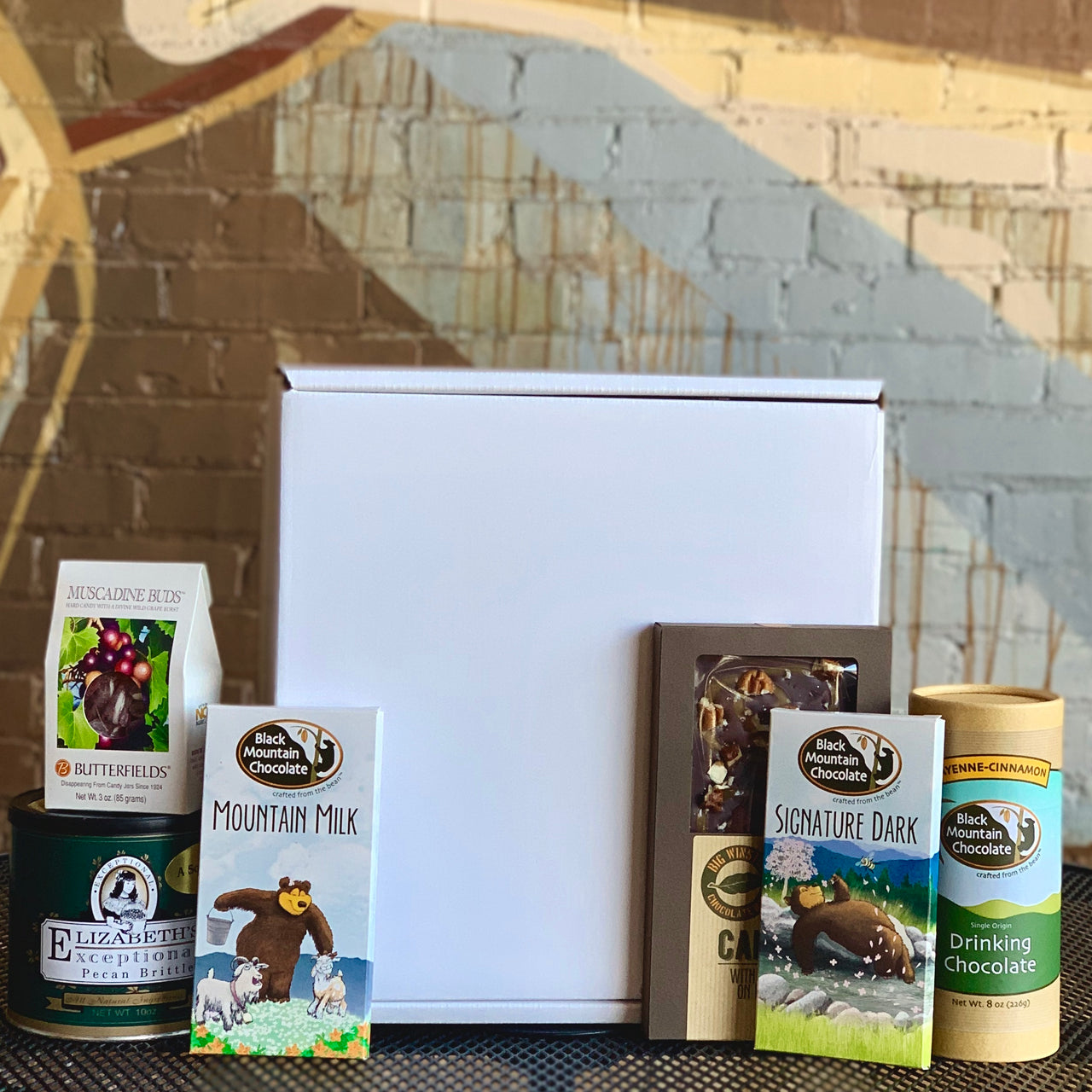 Black Mountain Chocolate makes the BEST gift!  Customize your own gift box by filling it with your BMC favorites- hand crafted chocolate, local NC treats, Dynamite Roasted Coffee or Chad's Chai!  You decide the contents, price point, and what will best please your friends and family! All products local to Winston-Salem, or North Carolina.