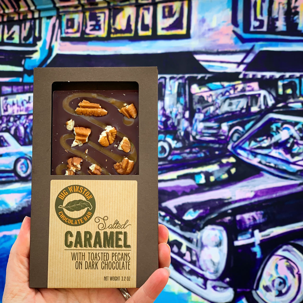Our Salted Caramel Big Winston Combines our Dark Chocolate with a decadent drizzle of Salted Caramel and a crunch of Toasted Pecans.  Sweet, salty, and Chocolatey, its a taste of the south!