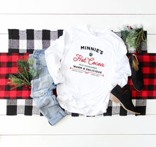 Load image into Gallery viewer, Christmas Mockup on blankets with Minnie's Hot Cocoa White Long Sleeve Shirt with Vintage Style lettering.