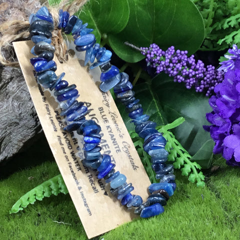blue kyanite chip beaded bracelet with woodland background and purple flowers