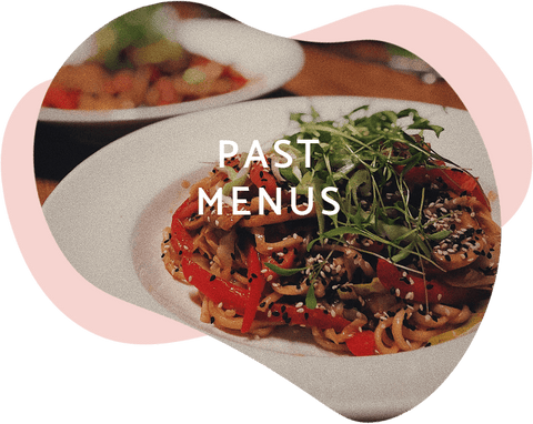 the text 'past menus' set on top of a photo of a delicious looking noodle and vegetable dish