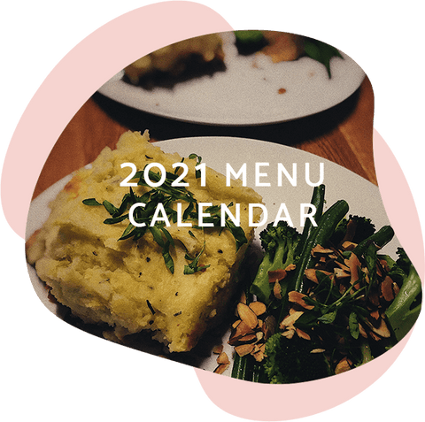 the text 'menu 2021' set on top of a photo of a delicious looking potato and vegetable meal