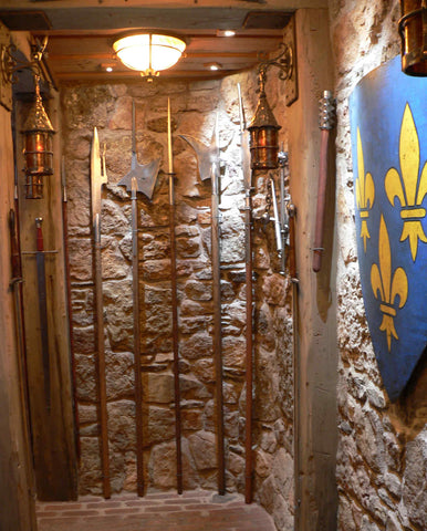A guard room in domestic castle man cave upper hall polearms.