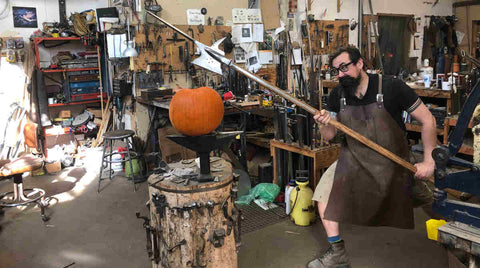 Pumpkin on anvil is threatened by halberd.