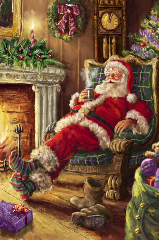 Santa relaxing in front of fire