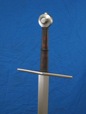 Arms & Armor Towton Longsword hilt view on blue background.