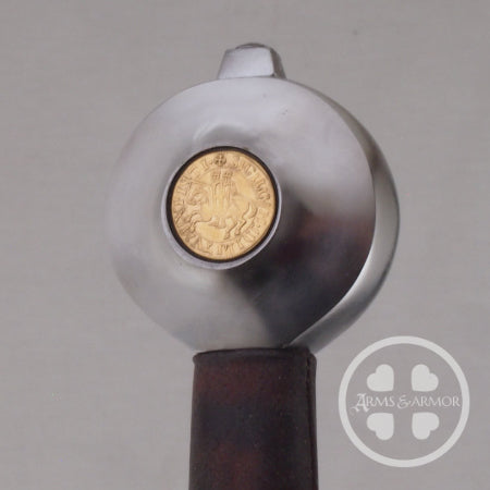 Pommel with coins inset.