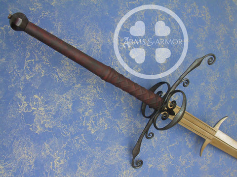 Two Handed sword with side rings with decorative detail.