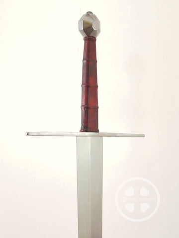 Large XVIIIc long sword with dark red ribbed grip and octagon pommel.