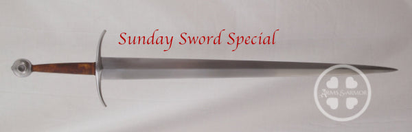 Large brown gripped Type XV sword with down turned guard.