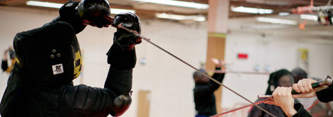 CBA fencers in high bind with longswords.