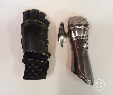 Modern gauntlet side by side with medieval gauntlet for size comparison.
