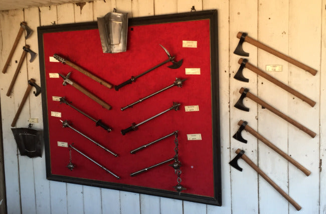 Axe wall at the booth of Arms & Armor Inc.