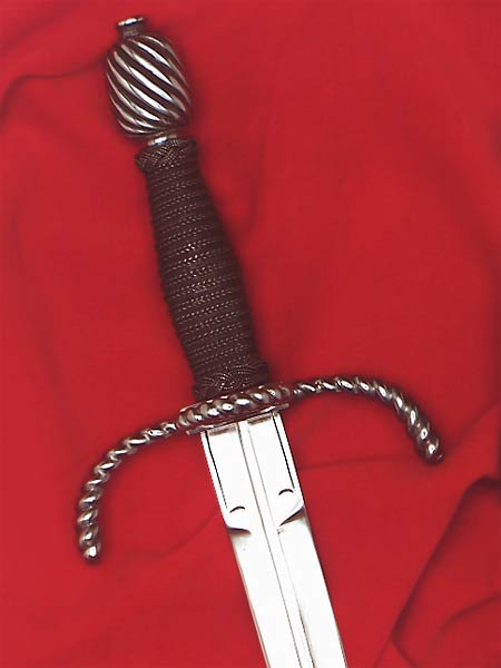 Writhen Parrying Dagger #159 matches the Writhen Rapier is style with twisted arms of the guard and ring bent forward towards the blade tip and a barrel shaped pommel also writhed in detail.