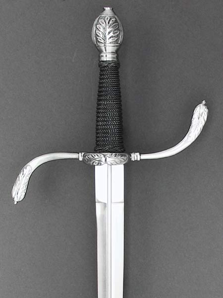 German Parrying dagger #196 with S shaped guard with ring and acanthus leaf detail and a wire bound grip.