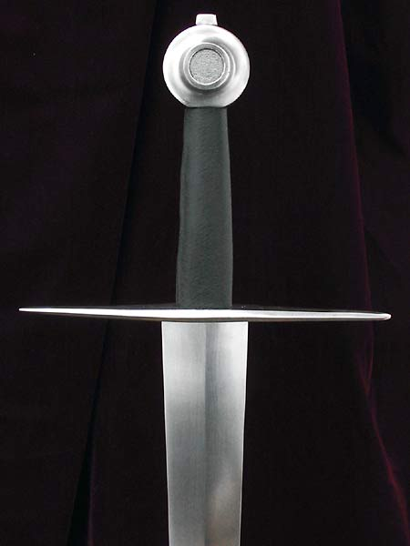 14th century Italian sword of type XV. Sword hilted with classic wheel and straight guard on single handed tapering blade.