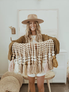 brown and white wooden bead tassel
