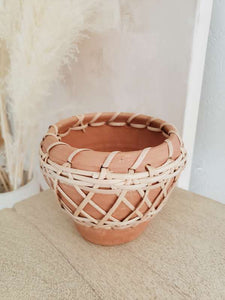 small terra cotta and rattan pot