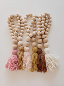 rust wooden bead tassel