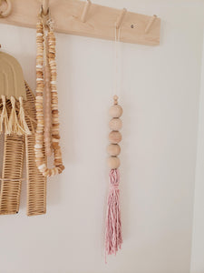pink/purple beaded tassel wall hanging