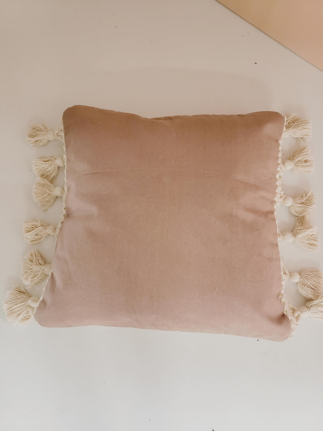 pillow with macrame tassels