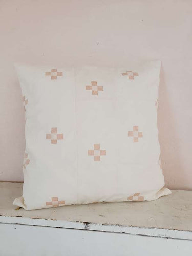 blush patterned pillow