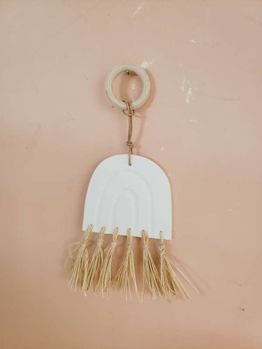 white clay rainbow wall hanging