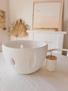white bowl with cutouts