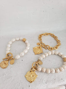 white beads with gold toggle bracelet