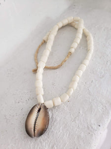 Tribal cowrie shell layering necklace