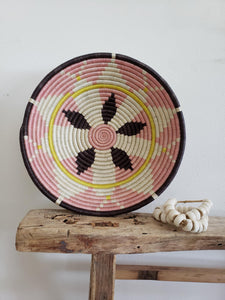 pink yellow and white hanging bowl