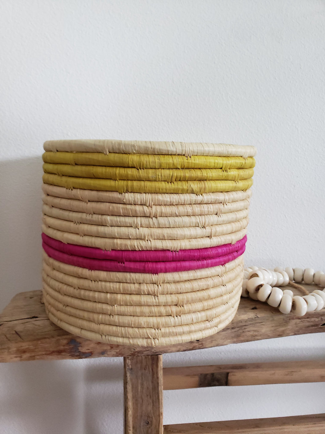 pink and yellow woven basket