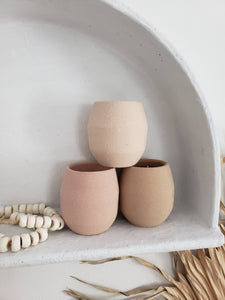 earthen ceramic candle