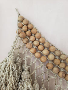 Wood bead and tassel wall hanging