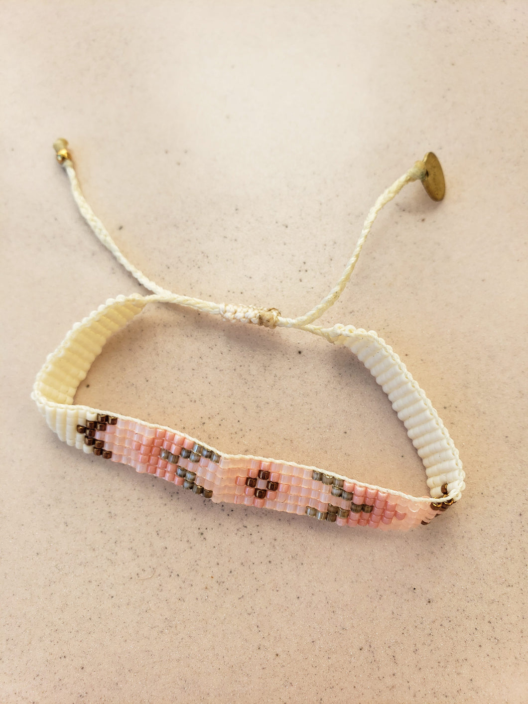 pink patterned beaded layering bracelet