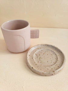 beige ceramic mug and plate set