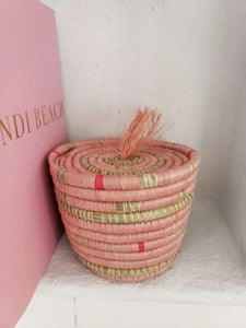 pink woven basket with lid