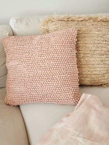 Pink knotted textured pillow