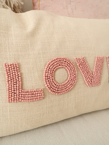 Pink beaded love pillow
