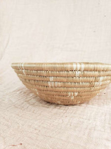 white patterned woven bowl