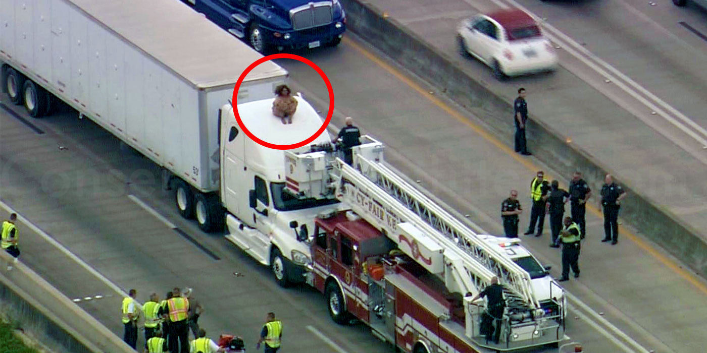 Naked Texas woman stops traffic dancing atop 18-wheeler