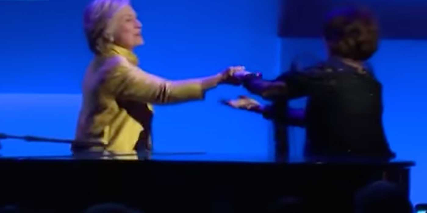 VIDEO: Woman kisses Hillary Clinton's hand on stage at awards ceremony