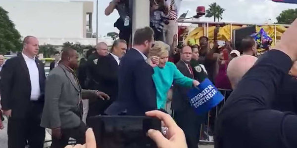 WATCH: Hillary Struggles To Climb One Step (VIDEO)