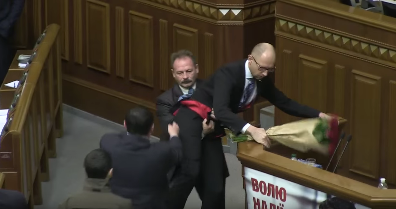 Man Grabs Ukrainian Prime Minister And Tries To Carry Him Away (Video)