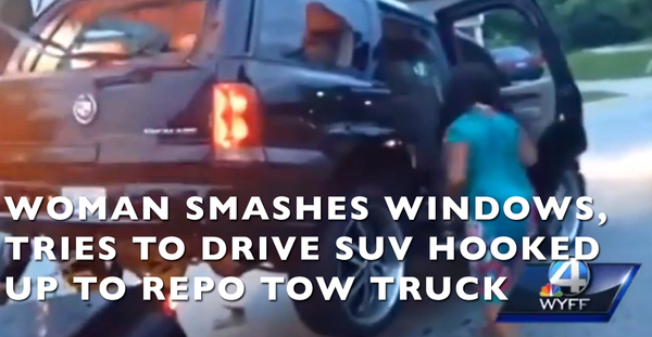 Woman Smashes Windows & Tries To Drive SUV Hooked To Repo Tow Truck