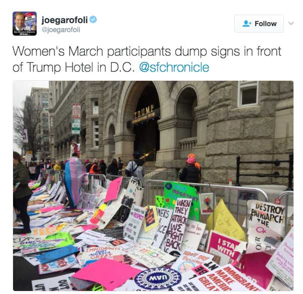 Women's March participants dump signs in front of Trump Hotel in D.C.