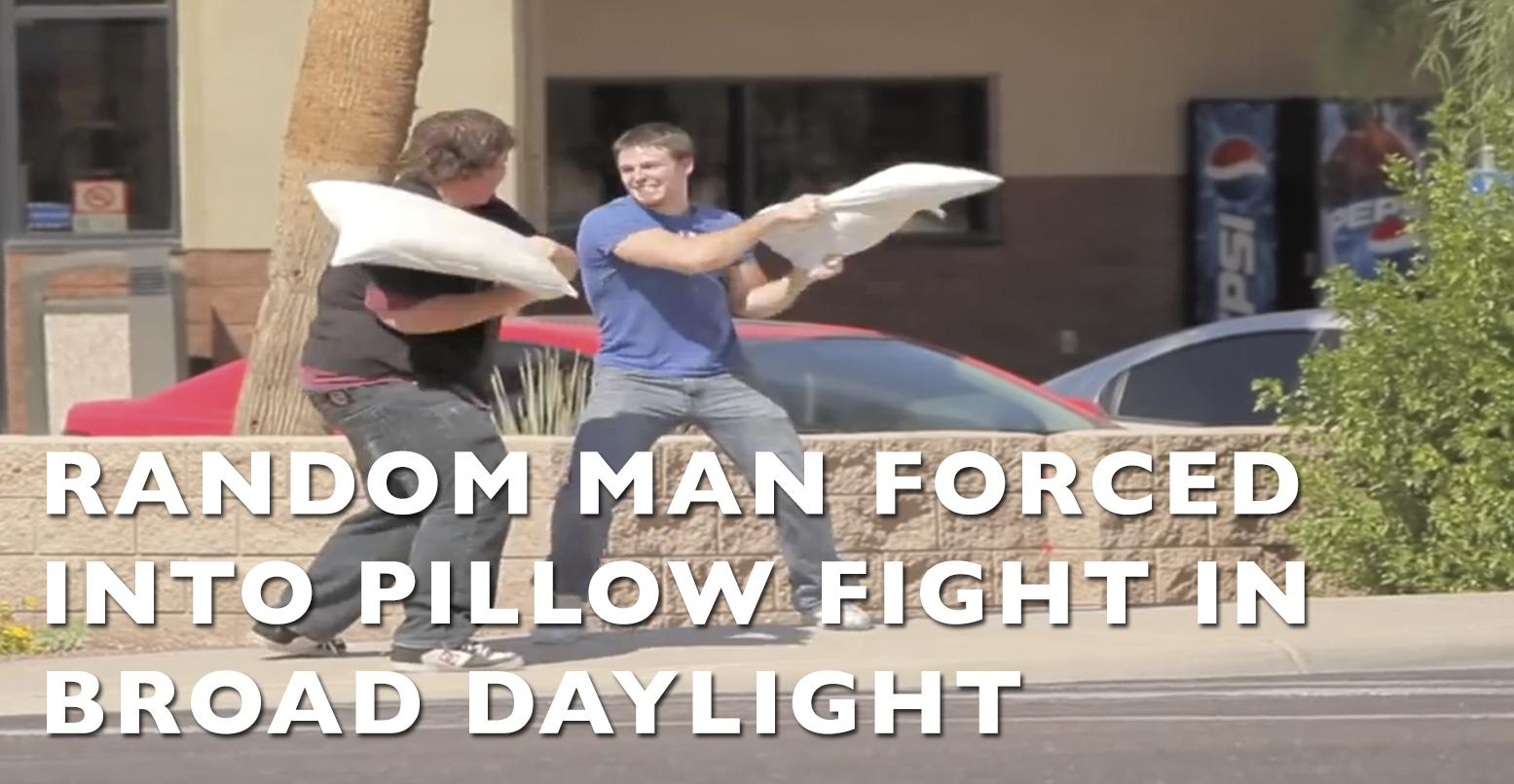 VIDEO: Random Man Forced Into Pillow Fight In Broad Daylight