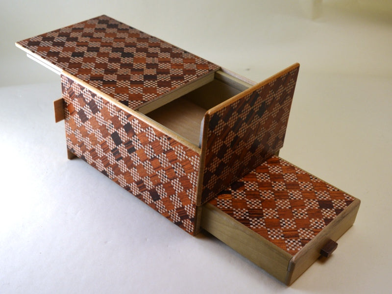 products/6_Sun_10_Step_Red_Ichimatsu_Japanese_Puzzle_Box_with_Secret_Drawer_1.jpg